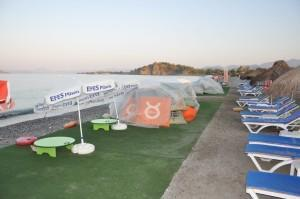 Beach furniture and carpeting cover Fethiye nesting beach