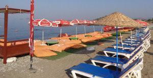 Nesting zone occupied by beach furniture and carpets in Fethiye, Turkey.
